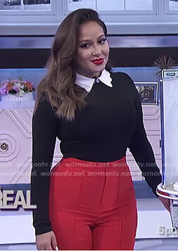 Adrienne's black scalloped collar top and red pants on The Real