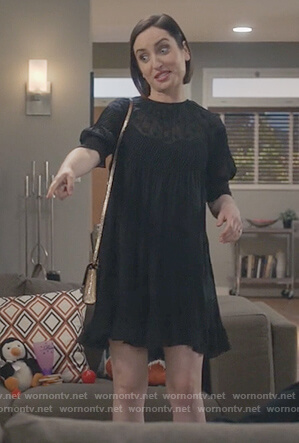 Jen's black polka dot mini dress on Life in Pieces