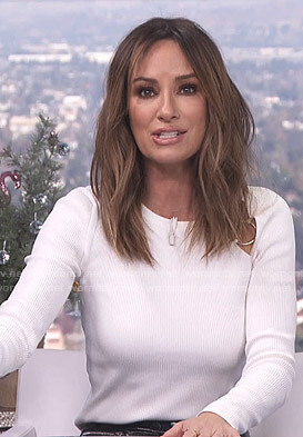 Catt's white ribbed top with rings on E! News Daily Pop