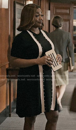 Daisy's black dress with front stripes on Madam Secretary