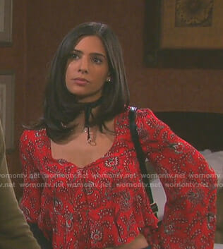 Gabi's red printed v-neck top on Days of our Lives