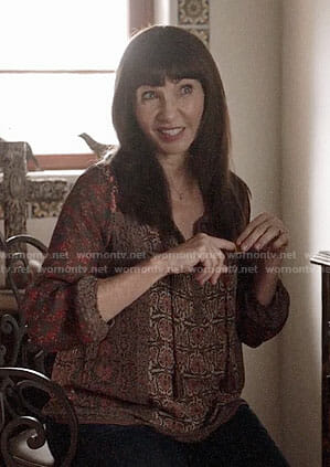 Gail's red printed top on Last Man on Earth
