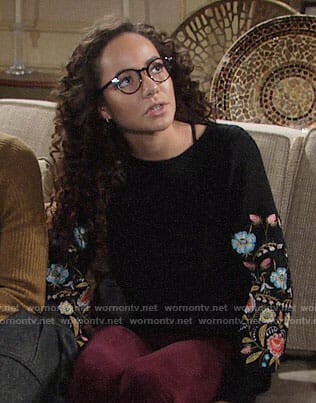 Mattie's black sweater with floral embroidered sleeves on The Young and the Restless