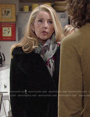 Nikki's black coat and butterfly print scarf on The Young and the Restless