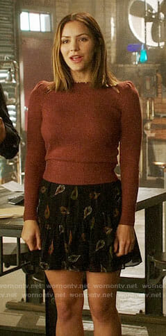 Paige's puff-shoulder sweater and feather print skirt on Scorpion