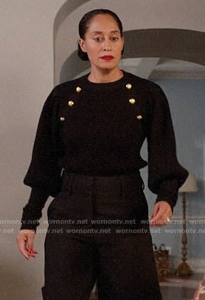Rainbow's black sweater with gold buttons on Black-ish