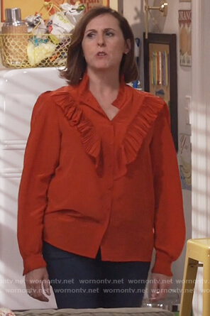 Val's red ruffle front top on Will and Grace