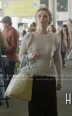 Scarlett's beige ruffled sweater on Nashville