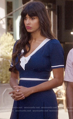 Tahani's navy dress with white bow on The Good Place