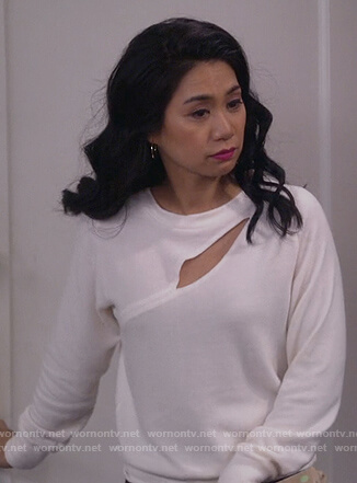 Eve's white cutout sweater on 9JKL