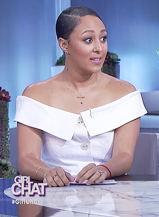 Tamera's white off shoulder jumpsuit on The Real