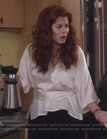 Grace's white v-neck top on Will and Grace
