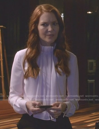 Abby's white scarf tie neck blouse on Scandal