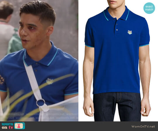Tiger polo shirt by Kenzo worn by Vivek Shah (Jordan Buhat) on Grown-ish