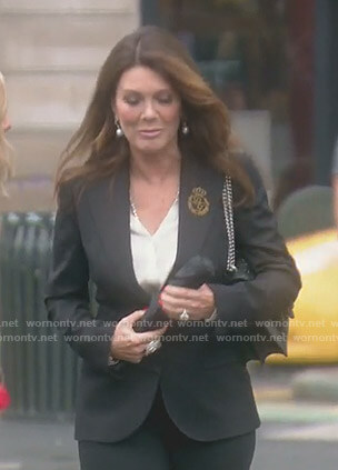 Lisa's black blazer with logo patch on The Real Housewives of Beverly Hills