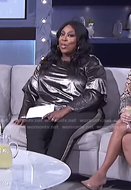 Loni's metallic ruffled sleeve top and side striped pants on The Real