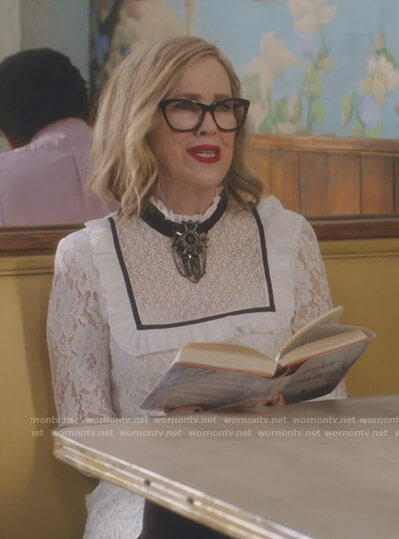 Moira's white bib front lace dress on Schitt's Creek