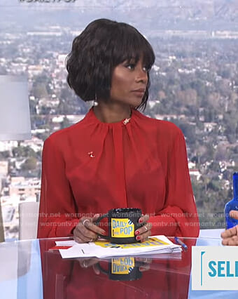 Zuri's red pleated neck blouse on E! News Daily Pop