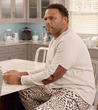 Andre's leopard print pants and elbow patch sweater on Black-ish