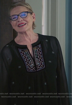 Joan's black v-neck embroidered top on Life in Pieces