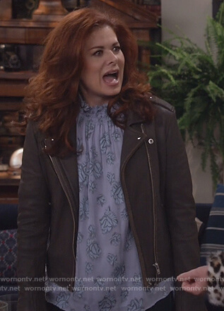 Grace's black leather moto jacket and floral top on Will and Grace