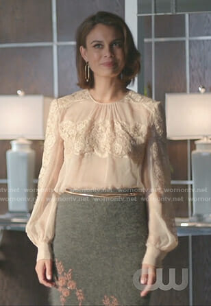 Cristal's nude lace blouse and grey floral skirt on Dynasty
