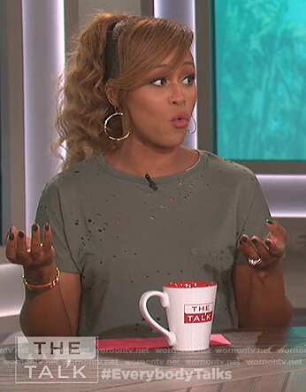 Eve's green distressed tee and palm tree skirt on The Talk