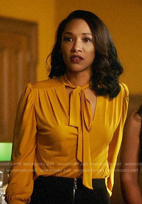 Iris's yellow tie neck blouse on The Flash