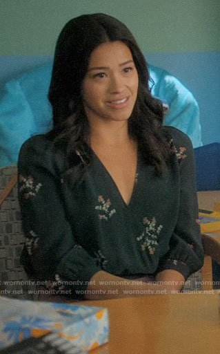 Jane's dark green floral wrap top on Jane the Virgin