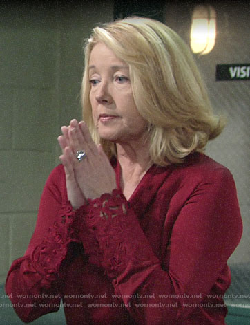 Nikki's red blouse with cutout cuffs on The Young and the Restless