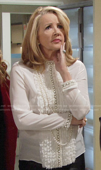 Nikki's white ruffled blouse with pearl buttons on The Young and the Restless