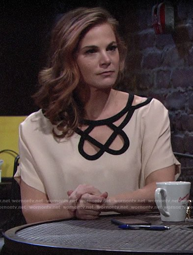 Phyllis's off-white blouse with black cutouts on The Young and the Restless