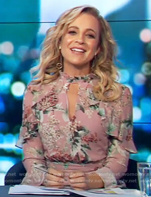 Carrie's pink ruffle playsuit on The Project