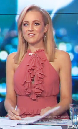 Carrie's pink ruffled dress on The Project