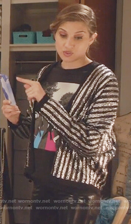 Nomi's metallic striped jacket and beatles t-shirt on Grown-ish