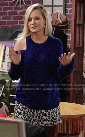 Sharon's blue sweater with cutout shoulder and leopard print skirt on The Young and the Restless