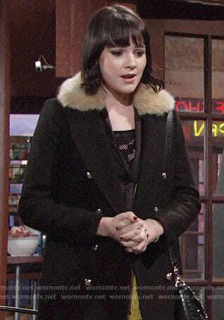 Tessa's black coat with fur collar on The Young and the Restless