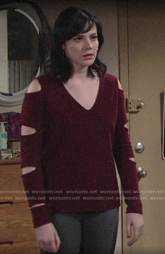 Tessa's red sweater with sleeve cutouts on The Young and the Restless