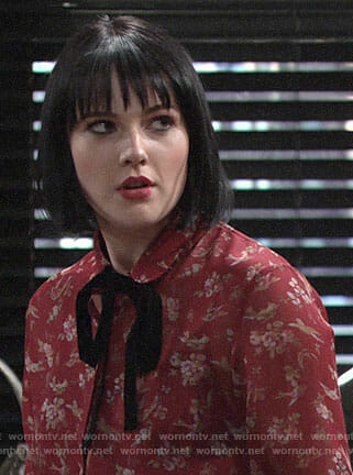 Tessa's red floral blouse with velvet tie neck on The Young and the Restless