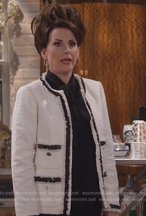 Karen's white tweed jacket and black bow top on Will and Grace
