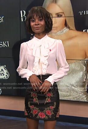 Zuri's white ruffled blouse and floral mini skirt on E! News
