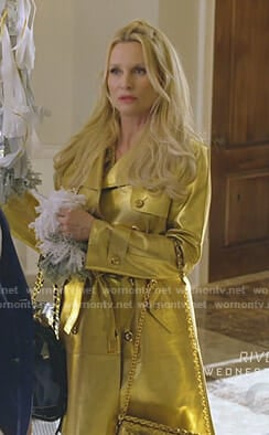 Alexis's gold trench coat on Dynasty