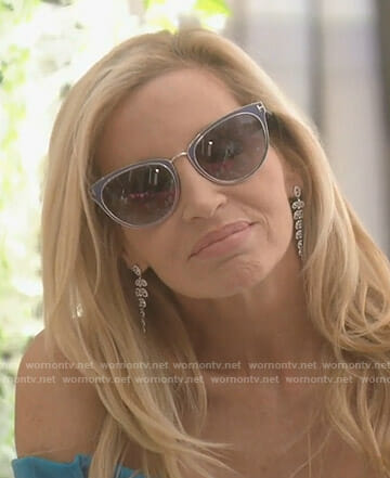 Camille's blue frame sunglasses and leaf drop earrings on The Real Housewives of Beverly Hills