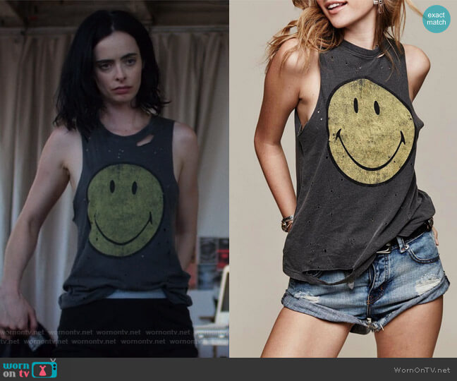 Destroyed Smiley Tank Top by Daydreamer worn by Jessica Jones (Krysten Ritter) on Jessica Jones