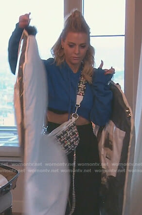 Dorit's blue cropped hoodie and tweed bag on The Real House wives of Beverly Hills