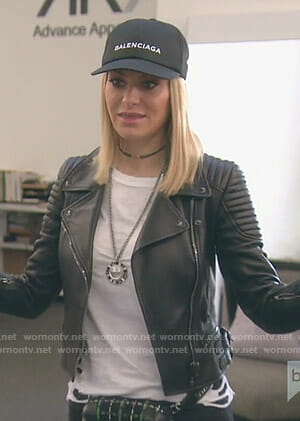 Dorit's white distressed tee and ribbed shoulder moto jacket on The Real Housewives of Beverly Hills
