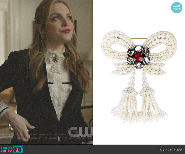 Pearl Embellished Bow Brooch by Gucci worn by Elizabeth Gillies on Dynasty