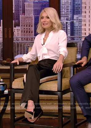 Kelly's white tie neck blouse and side stripe trousers on Live with Kelly and Ryan
