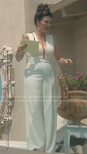 Lisa's white jumpsuit with barbells on The Real Housewives of Beverly Hills