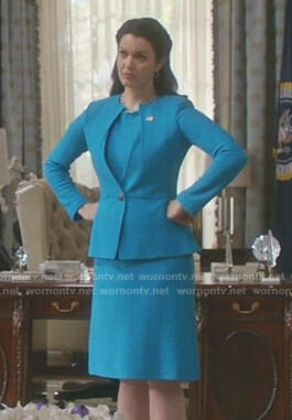 Mellie's turquoise blue dress and split neck jacket on Scandal